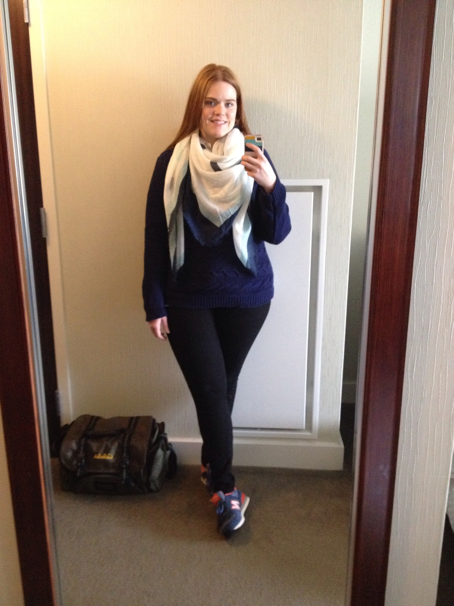 fashion blogger scarf travel lookbook new balance sneakers outfit ootd navy fisherman sweater